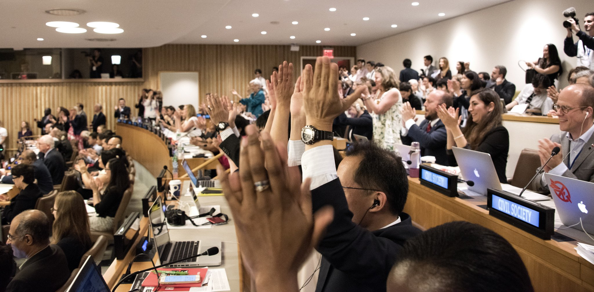Delegates applaud the passing of the treaty